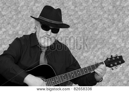 Senior is playing the guitar