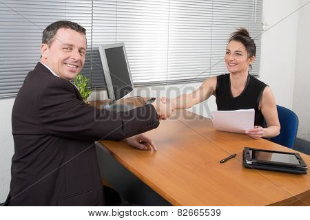 Man Meeting Financial Adviser At Her Office