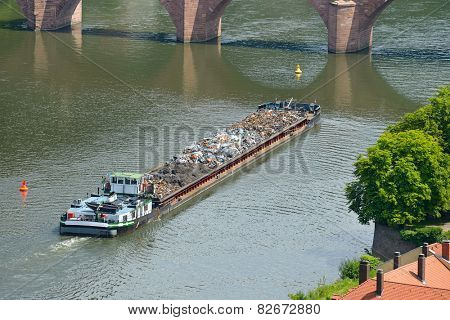 Barge transports waste on the river poster