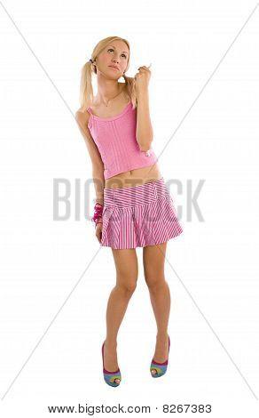 Uma boneca viva. A menina em rosa