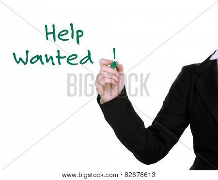 Businesswoman's hand writing Help Wanted at transparent whiteboard