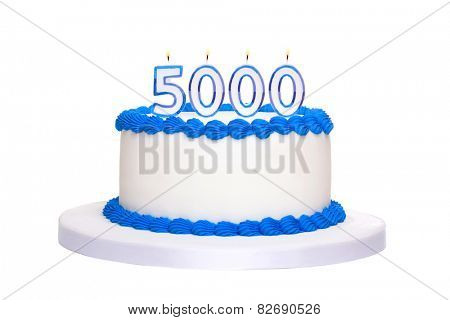 Birthday cake with candles reading 5000