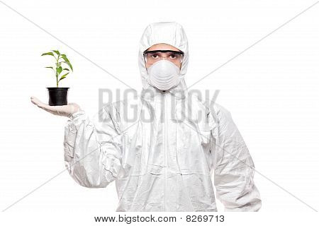 A man in uniform holding a plant isolated on white background poster
