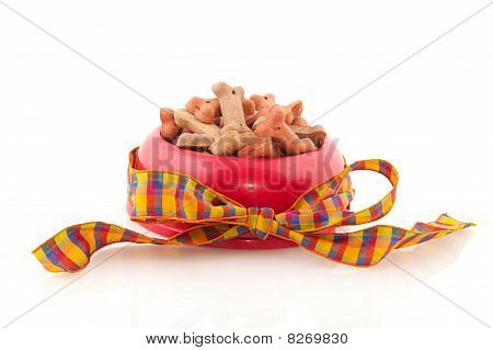 bowl with dog cookies for international world animal day poster
