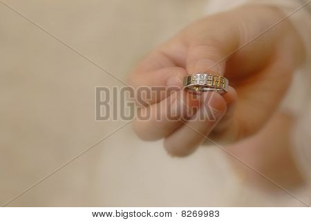 Womens Hand Holding A Wedding Ring