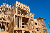 Wooden framing for construction of new condominiums, apartments or townhomes poster