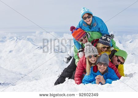 Group Of Friends Having Fun On Ski Holiday In Mountains