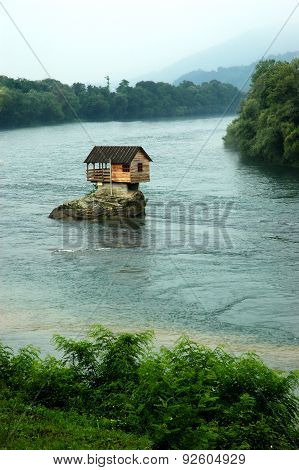 House On A Rocky Island on a river Drina In Serbia