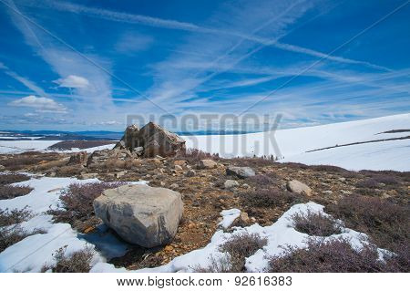 Snow And Boulders In California Mountains