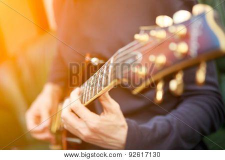 Electric guitar player. Sun lensflare