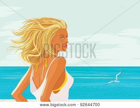 Beautiful blonde with long streaming hair at the sea