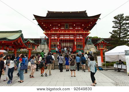 Japanese people and tourists enter Fushimi Inari Shrine in Kyoto