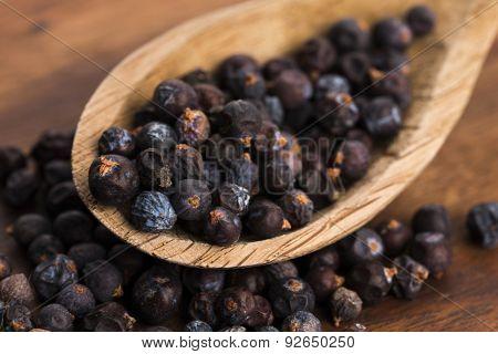 Juniper Berries On A Wooden Background