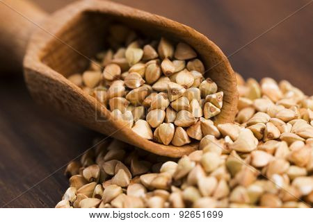 Buckwheat With A Spoon On A Wooden Boards Background