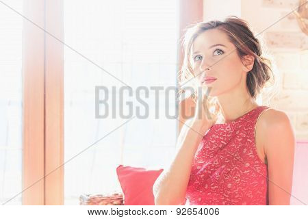 Beautiful Brunette Woman Sitting Near A Sunny Window