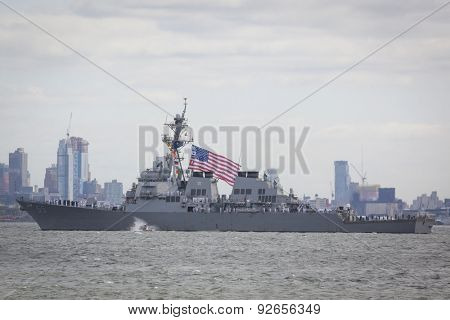STATEN ISLAND, NY - MAY 20 2015: The American Flag flies from the USS Stout (DDG 55) as the ship travels on the Upper Bay towards Manhattan during the Parade of Ships, which begins Fleet Week.