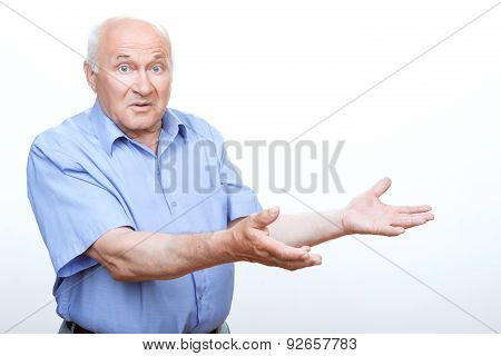 Confused grandfather holding hands up