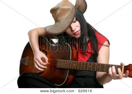 a woman playing country and western music on a guitar poster