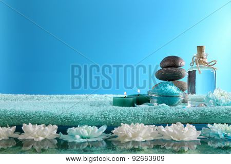 Spa still life with chrysanthemum on blue background