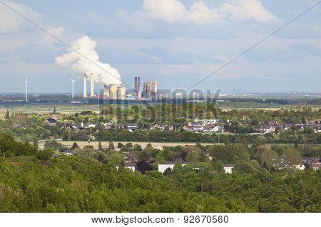 Distant Power Station In Rural Landscape