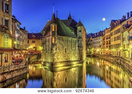 Palais de l'Ile jail and canal in Annecy old city, France, HDR