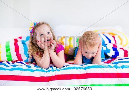 Children Sleeping Under Colorful Blanket
