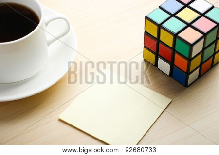 Note With Rubik's Cube And Coffee
