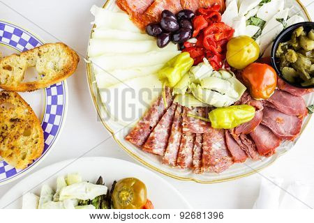 Appetizers plate with vegetarian antipasto in Italian restaurant. poster