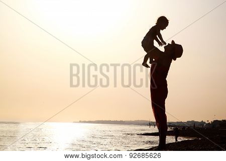 Woman with baby at the sunset