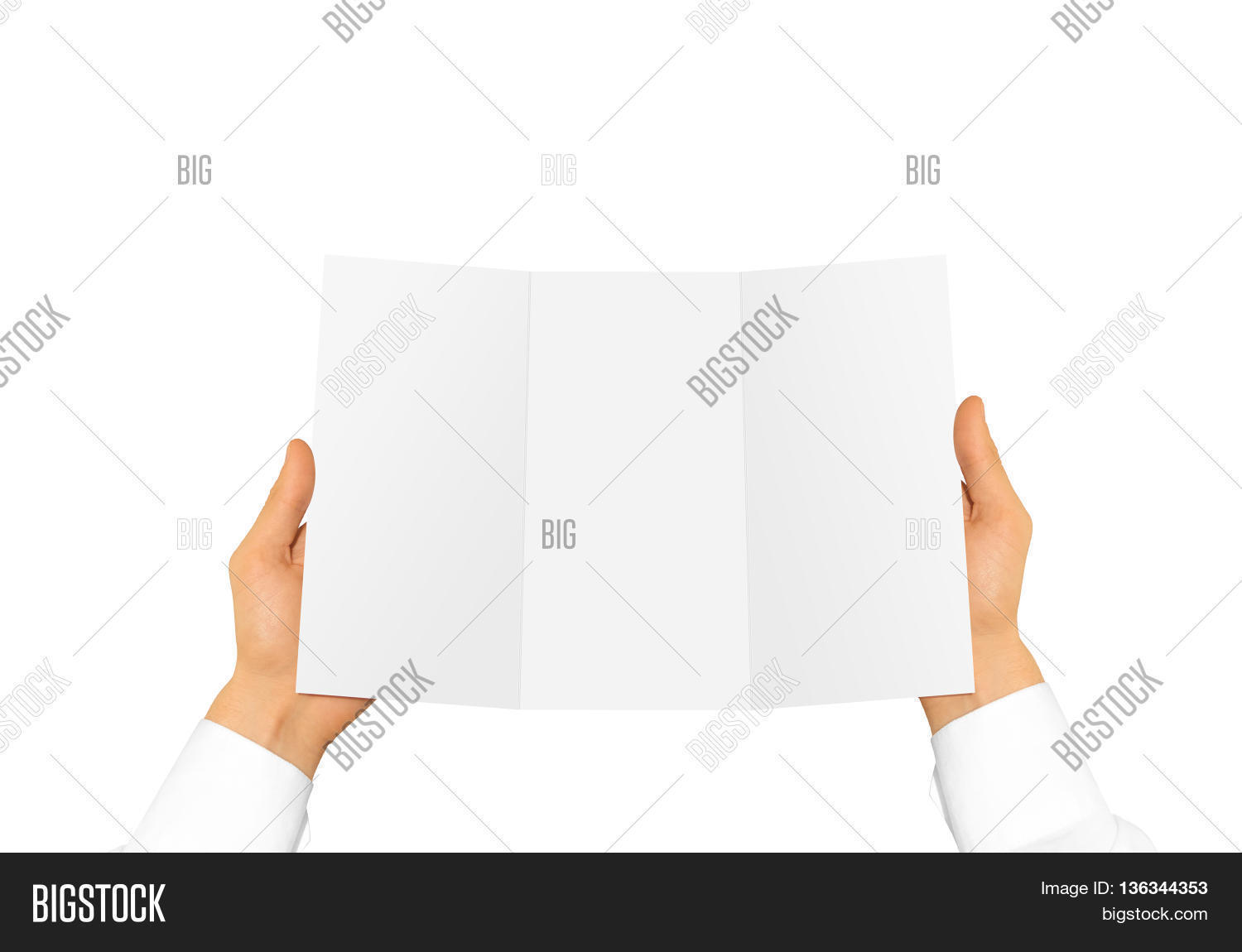 Hand in white shirt sleeve holding blank offset paper in the hand. Empty  leaflet presentation