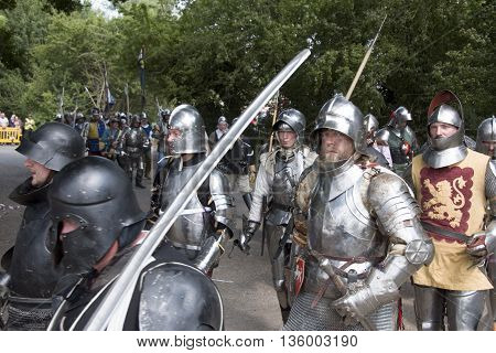 Tewkesbury UK-July 17 2015: Knights in armour marching toward battle on 17 July 2015 at Tewkesbury Medieval Festival