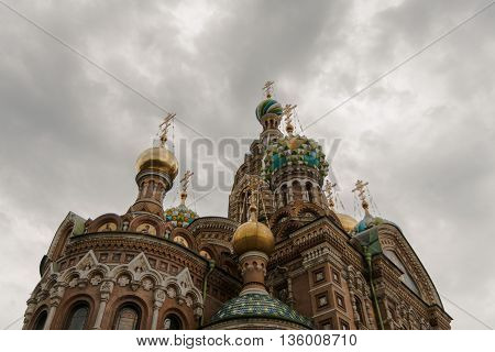 Church of the Savior on the Blood of Christ or the Church of the Saviour on Spilled Blood from the bottom up on a background of clouds.