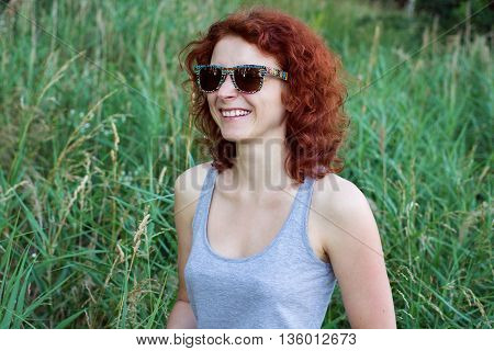 Close Up Portrait Of A Curly Ginger Woman