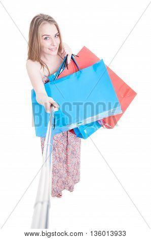 Smiling Beautiful Shopper Doing Shopping And Taking A Selfie