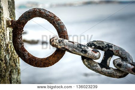 Old Rusty Anchor Iron Ship Chain In Sea Port.