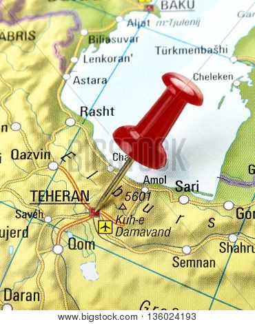 Map with selective focus and pin set on Teheran.