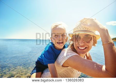 Happy Young Mother And Son On A Tropical Beach