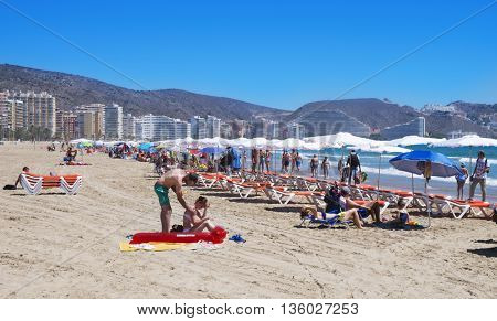 CULLERA, SPAIN - JUNE 23: Sunbathers at San Antonio Beach on June 23, 2016 in Cullera, Spain. It is the main beach in this popular tourist village in the Valencian Community