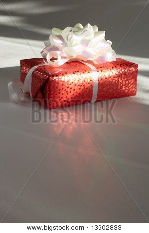 Gift  In Packing Is Lighted Up The Rays Of A Sun