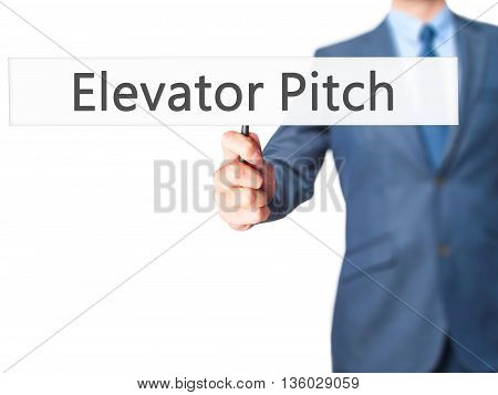 Elevator Pitch - Businessman Hand Holding Sign