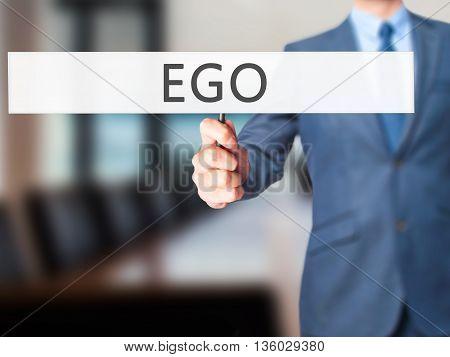 Ego - Businessman Hand Holding Sign