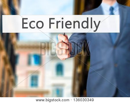 Eco Friendly - Businessman Hand Holding Sign