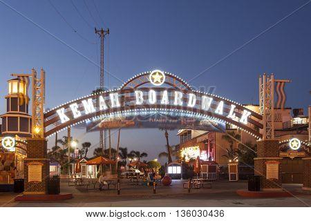 KEMAH TX - APR 14: Kemah Boardwalk entrance arch illuminated at night. April 14 2016 in Kemah Texas United States