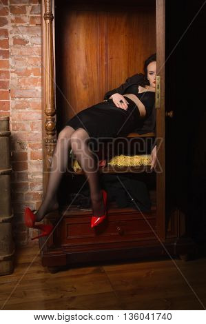 Dead Business Woman Dressed Black Suit In The Closet