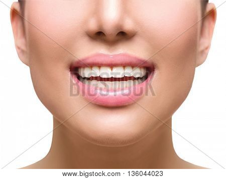 Healthy Smile. Teeth Whitening. Dental care Concept. Woman Smile Closeup. Girl with Beautiful Lips and Teeth