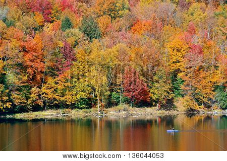 Lake with Autumn foliage and mountains in New England Stowe