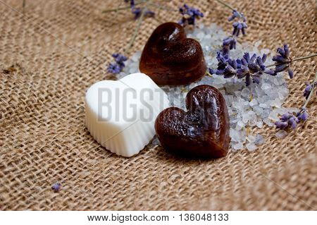Three Heart Soaps, Lavender Twigs And Bath Salt On Jute Underlay
