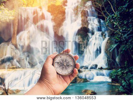 Hand Man Holding Compass At Kuang Si Waterfalls In Luang Prabang, Laos.