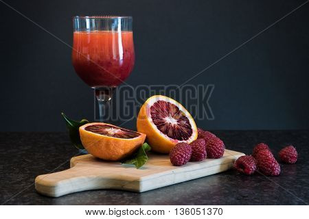 Blood orange berries and a glass of freshly squeezed juice