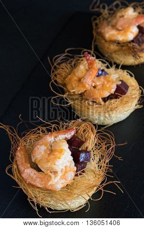 Appetizers with shrimps beetroot and kadayif dough